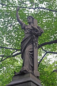 Woman with Cross Statue