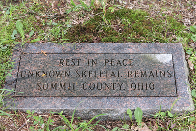 A grave marker for an unknown person behind the old Summit Count Home in Munroe Falls, Ohio