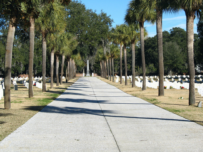 <b>Beaufort National Cemetery</b> - Created in 1863, during the Union occupation of Beafort, the cemetery is the final resting place for over 18000 veterans and their families. This is a view of the cemetery's main avenue.