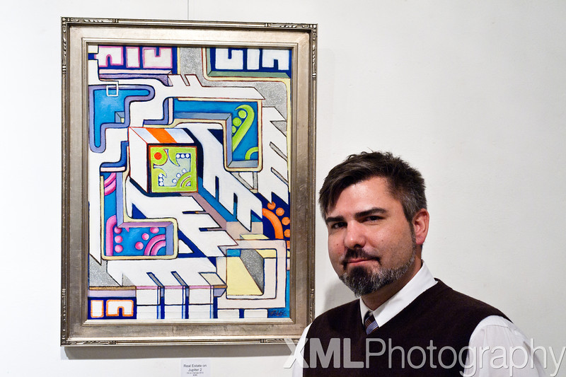 Archer Watkins with his painting: Real Estate on Jupiter 2