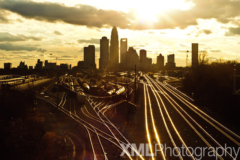 Charlotte, NC Skyline near sunset with railroad tracks and train. 2011.