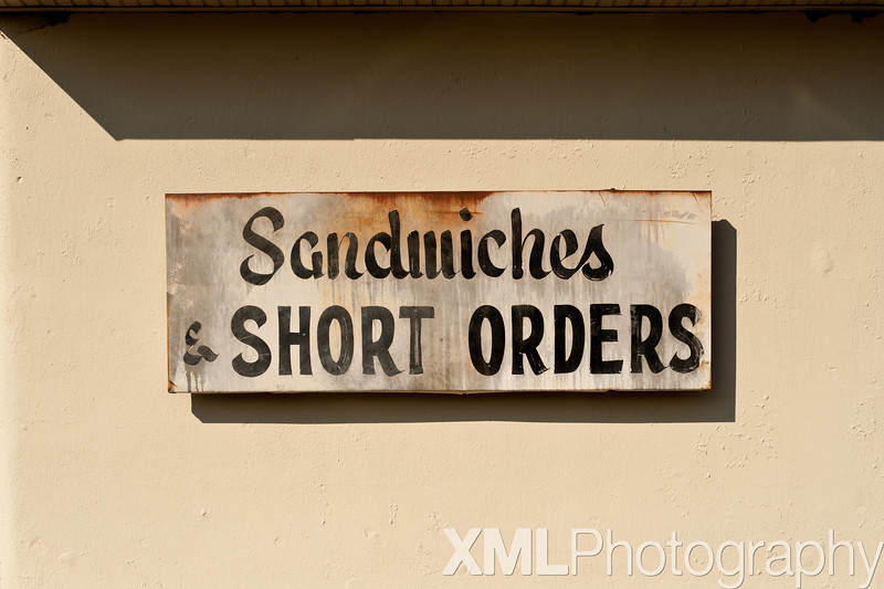 Sandwiches & SHORT ORDERS sign at the Penguin Drive-in