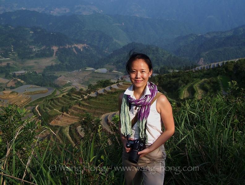 The photographer (Wang Hong) in Dazhai Village, Guangxi Province in 2010, by Ms. Lei Wang.