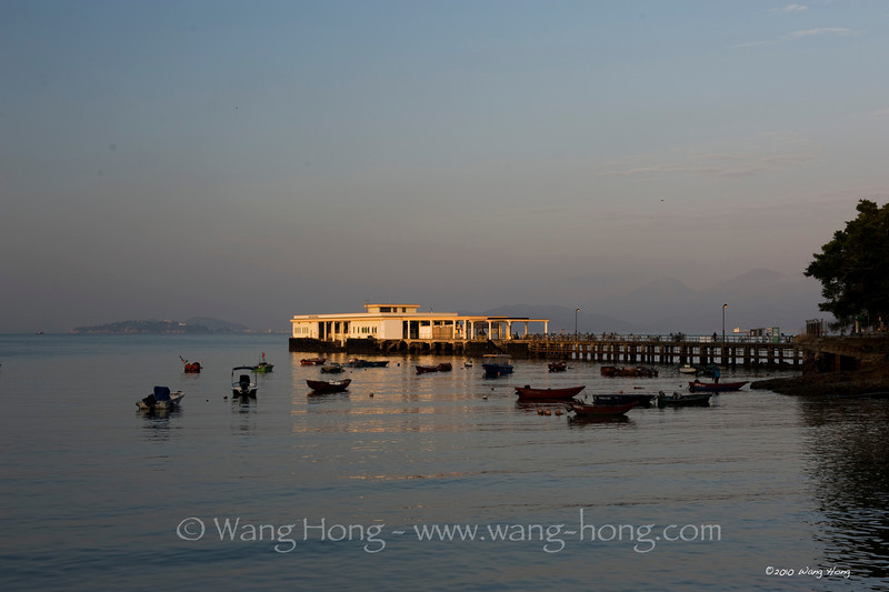 Yung Shue Wan Pier in early morning sunlight, Lamma Island