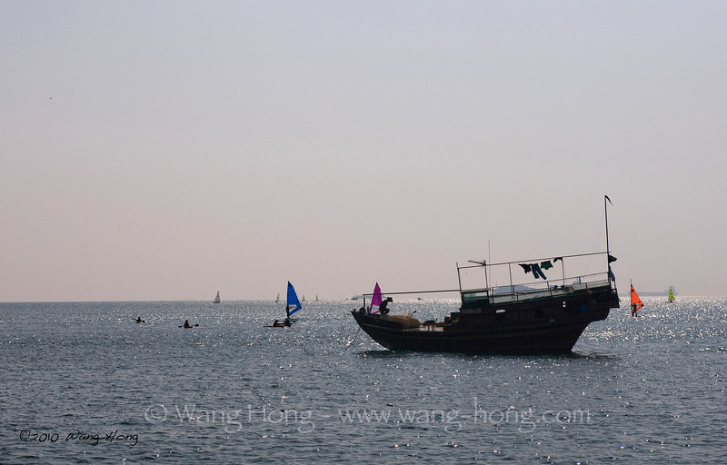 Fishing boat and sails off Stanley