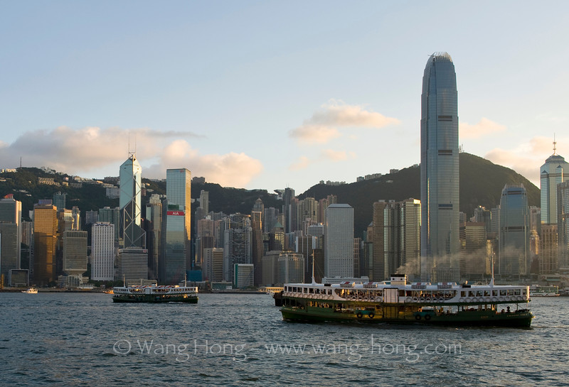 Star ferries in Victoria Harbour and HK skyline.
