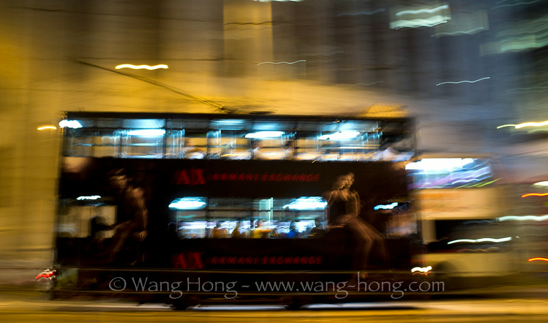 Hong Kong tram running on street in Central.