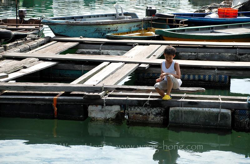 Island boy in a quiet idling mood.