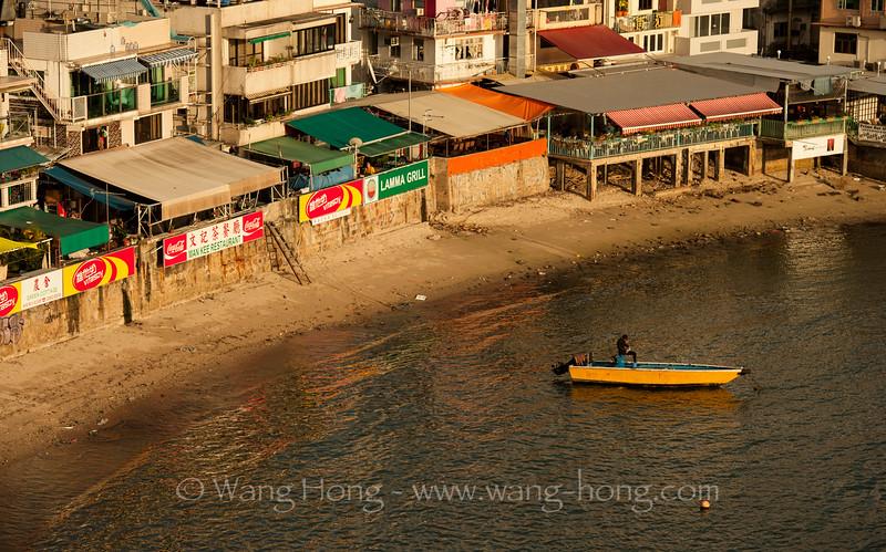 Restaurant row on water front of Yung Shue Wan, Lamma Island.