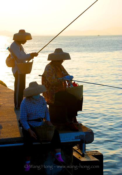 Old ladies fishing at Yung Shue Wan Pier, Lamma.