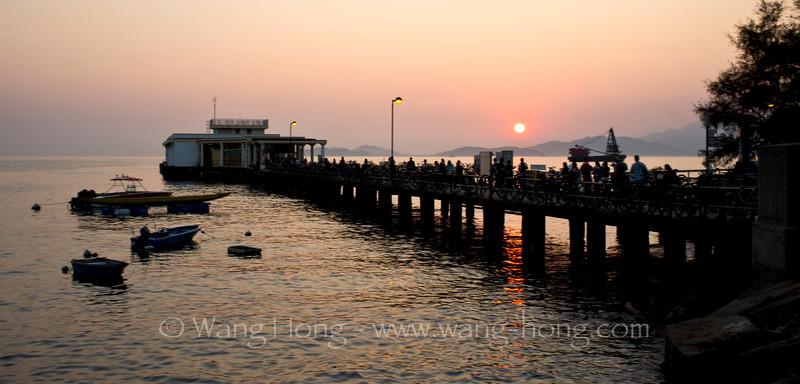 Sunset over Yung Shue Wan Pier.