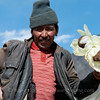 Mongolian man posing with snow lotuses