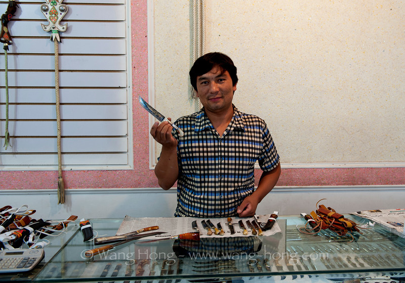 At a knife shop in Jengisar, South Xinjiang.