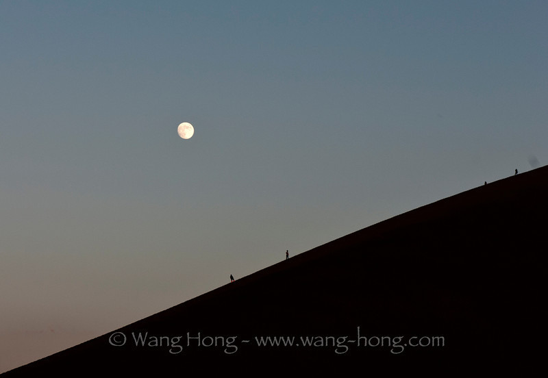Moon rising over sand dunes in Dunhuang, Gansu