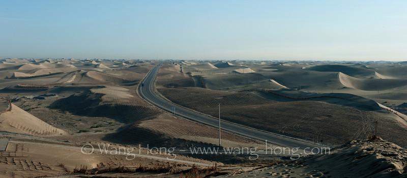 Highway from Hotan to Alar through Taklamakan Desert.