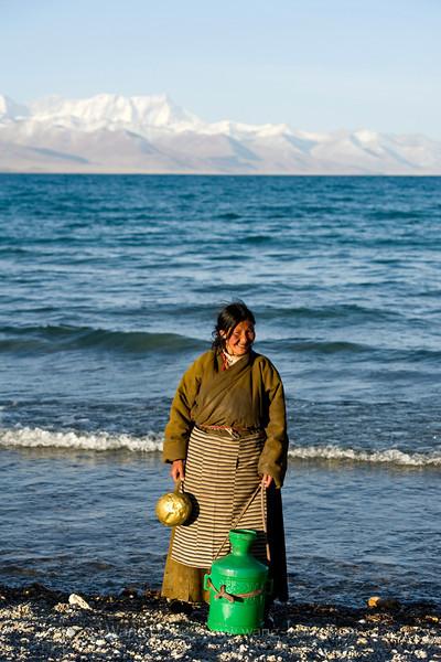 Tibetan woman by Namtso in early morning