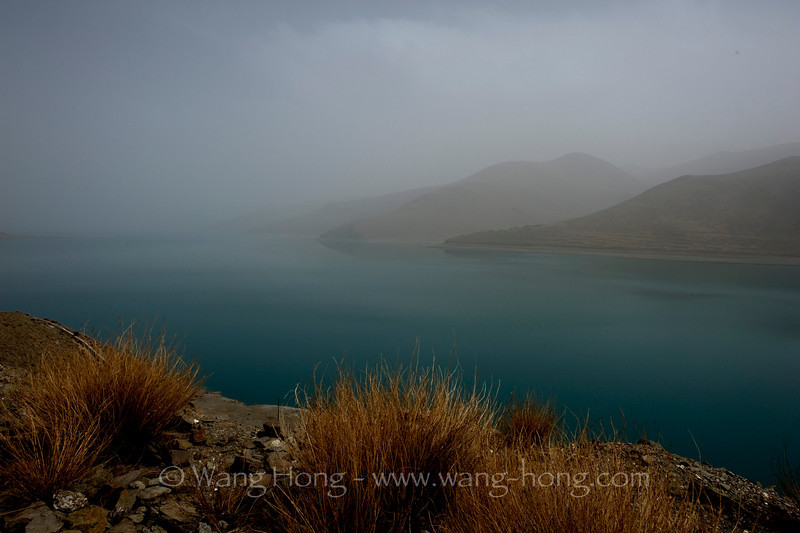 Yamdrok Lake (4441m) on a day of sand storm