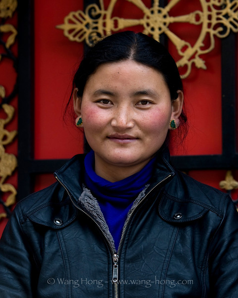 """Shy Tibetan girl at shop, who served us yak butter tea. Our guide Tibetan teased her: """"I'll come back to marry you""""."""