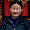 "Shy Tibetan girl at shop, who served us yak butter tea. Our guide Tibetan teased her: ""I'll come back to marry you""."