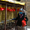 Turning the prayer wheels outside Drepung Monastry