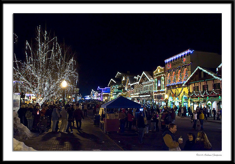 At night, the magic begins as the town is transformed with lights and revelry.