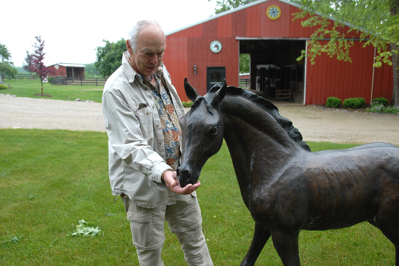 Mark trying to feed a foal...made of bronze.