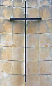Wooden Cross on Stone Wall