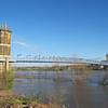 The river is high, flooding the low areas.