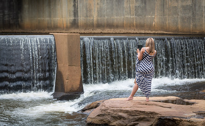 Girl shooting the Reedy River Falls
