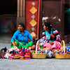 Women selling dolls, Mexico