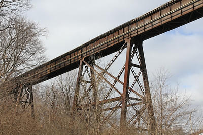 Looking up at an old but still used railroad brigle and trussle