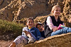 My daughter and two younger girls pose on rocks alongside one of the trails.