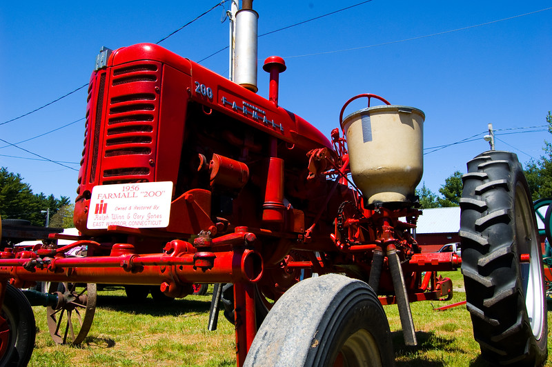 I really liked the contrasting colors. For some reason, I'm very fond of short focal lengths from very low angles.  Taken at Antique Engine and Tractor Show - Somers, CT, US