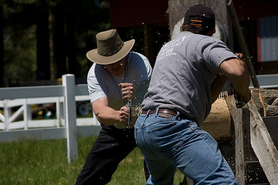 Men Working, Sawdust Flying.  Taken at Antique Engine and Tractor Show - Somers, CT, US