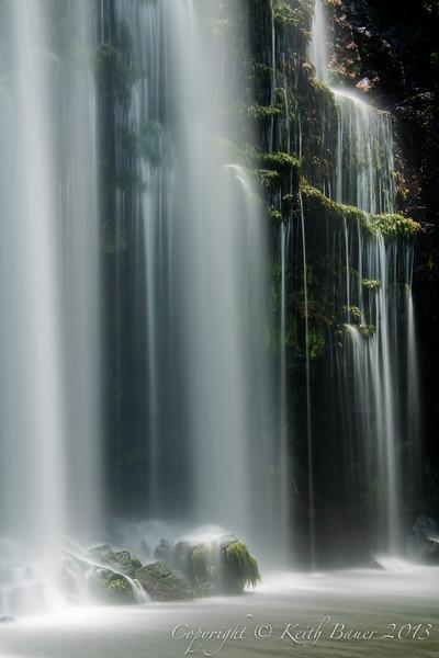 A view of a beautiful ribbon waterfall