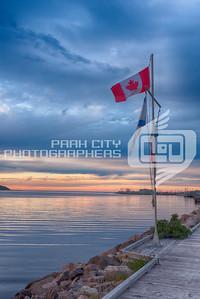 Canadian Flag over Cheticamp boardwalk