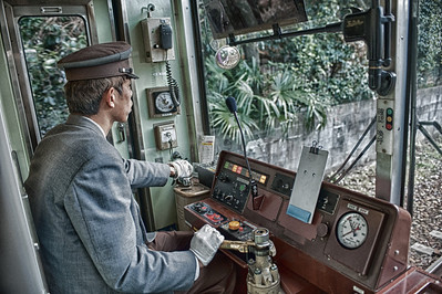 Engineer in the train that took us to Bamboo Forest.   HDR.