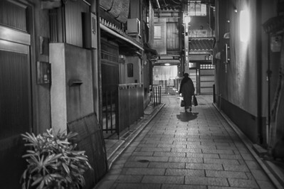 "Walking down an alley where ""michaelsons"" and ""geishas"" worked, I saw this woman rush out of one of the door ways.  Seconds later, she was gone."