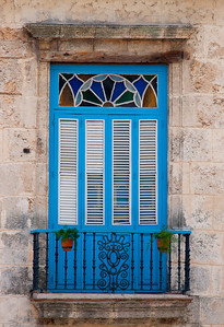Blue doors with stained glass