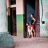 Mom and Daughter Waiting Out the Rain - Havana - Copyright 2017 Steve Leimberg UnSeenImages Com _Z2A5516