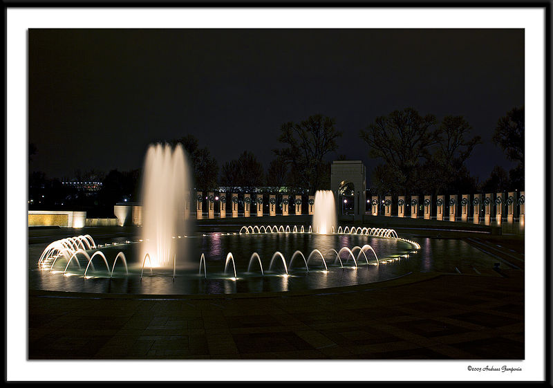 The World War II Memorial at night, looking from the ramp of the Pacific Pavilion towards the Atlantic Pavilion.