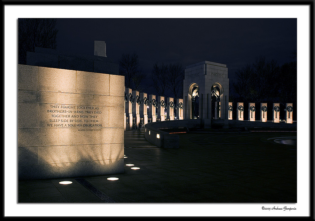 The wall leading to the ramp to the Pacific Theater Pavilion in the World War II Memorial.  Inscribed are the words:<br /> <br /> THEY FOUGHT TOGETHER AS BROTHERS-IN-ARMS. THEY DIED TOGETHER AND NOW THEY SLEEP SIDE BY SIDE. TO THEM WE HAVE A SOLEMN OBLIGATION. <br /> <br /> Admiral Chester W. Nimitz
