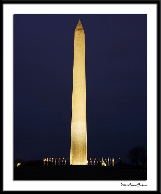 A view of the National Monument lit at night to be seen from miles away.