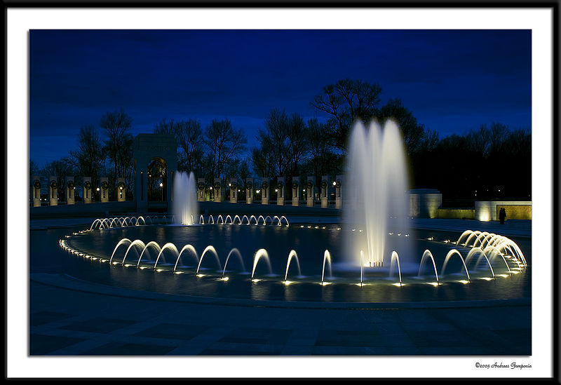 Another photograph in the early evening twilight of the rainbow pool of the World War II Memorial.