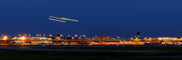 A plane takes off shortly after dusk.