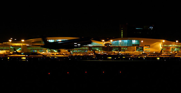 A night landing at DFW, in front of the terminal.