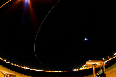A small commuter plane makes an early west turn on takeoff, captured with a fisheye lens.