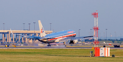 An American 767 touches down at DFW airport.