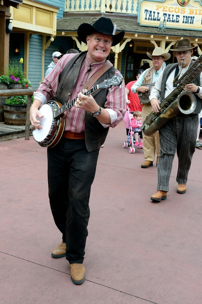 Magic Kingdom - If he was a true gentleman, he'd put the banjo back in the case.