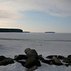 Green Bay, Lake Michigan, viewed from Ephraim, WI.  The track across the middle is from a track hoe, going out to dig a hole through the ice.  Land jutting out from left is Peninsula State Park